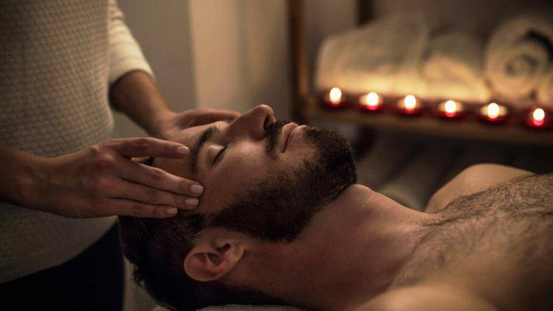 Man with beardiful beard getting a massage