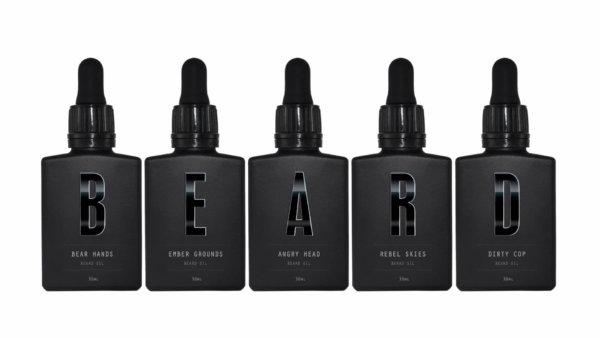 All five Beardifulman standard beard oils in a line spelling out BEARD